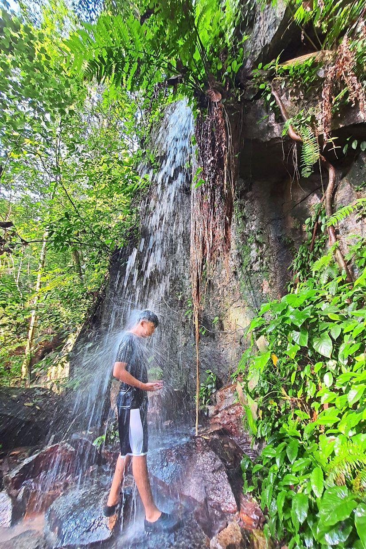 Woon enjoying the cool waterfalls at Bukit Seraya in Cherok To'kun Forest Reserve, Bukit Mertajam.