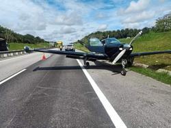 Light plane lands on highway