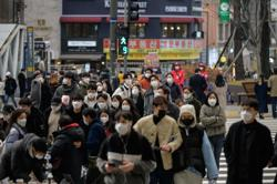 S. Korea reports surging Covid-19 cases as tighter curbs to take effect