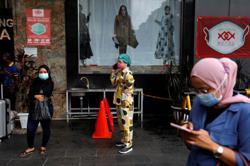 Indonesia hits half million coronavirus cases as hospitals strain