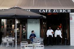 Barcelona bars spring back to life after five-week coronavirus closure
