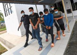 Four charged with polluting Sg Muda