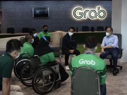 Grab drivers, delivery riders' complaints get Muhyiddin's attention