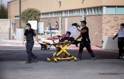 With U.S. hospitals overrun, surgeon general urges Americans to 'hold on'