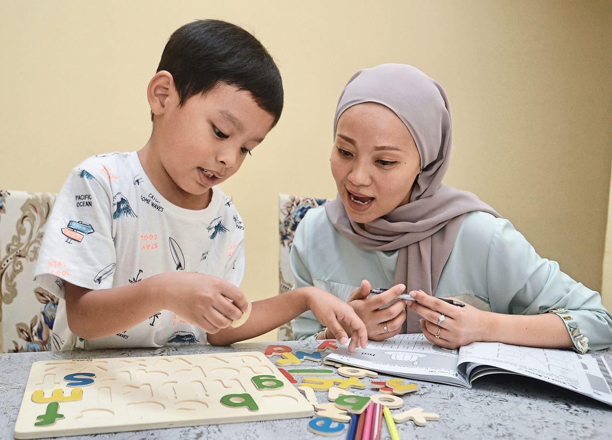 Dayana says her son Ariq has trouble staying focused when lessons are held online.