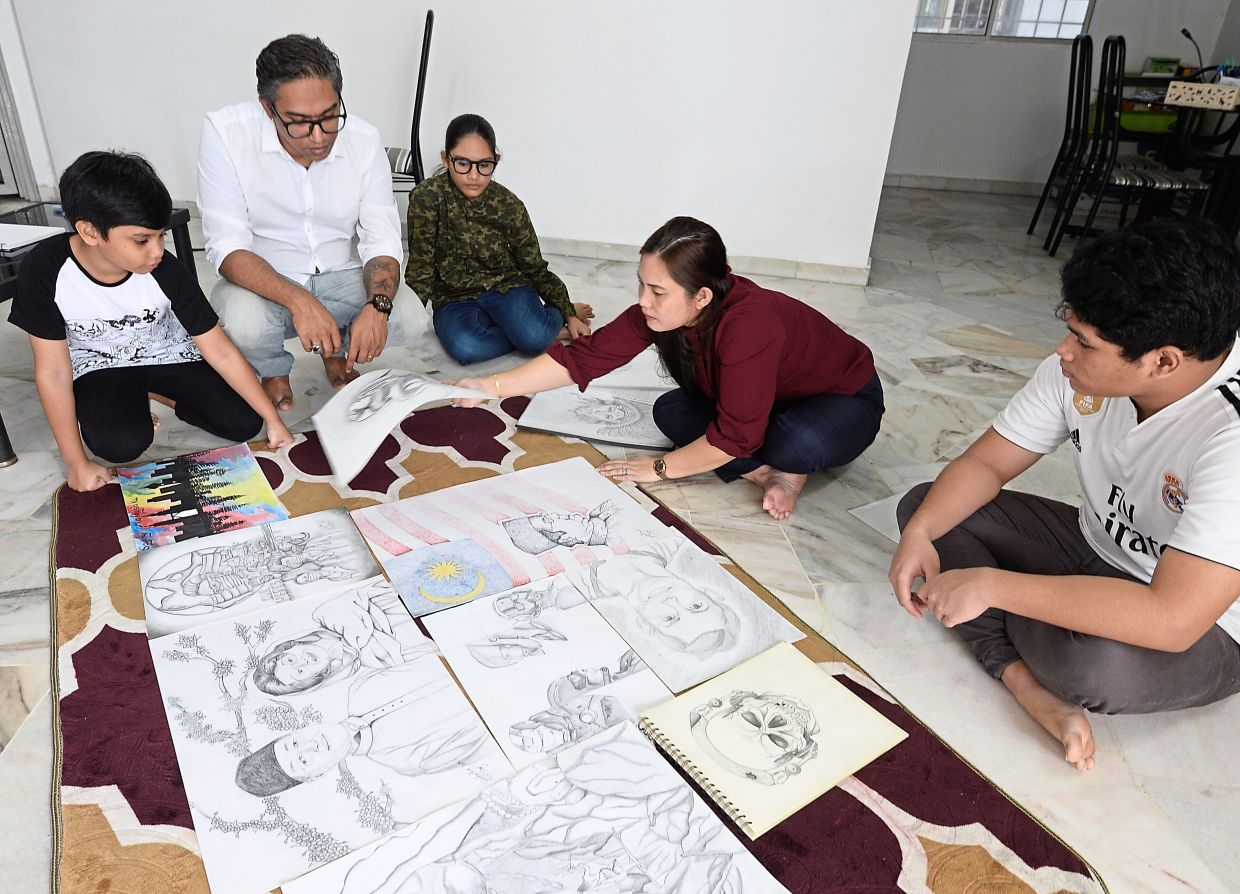 Josielyn (second from right) says art helps to boost the self-esteem of her sons.  With her are her husband Vijay Pillay and her children (from left) Kushal, Arysha and Siddartha.