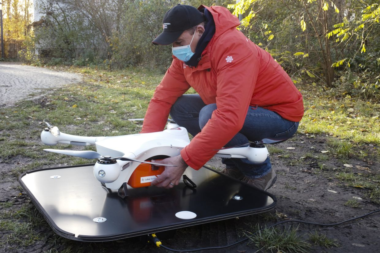 A drone and logistic operator shows how to lead a drone with a case for medical stuff during a presentation for media, near the Labor Berlin laboratory in Berlin, Germany. Each drone can carry about 40 test samples, not only for Corona tests, that need to be examined in a laboratory. — AP