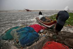 Tens of thousands evacuated as cyclone targets southeast India