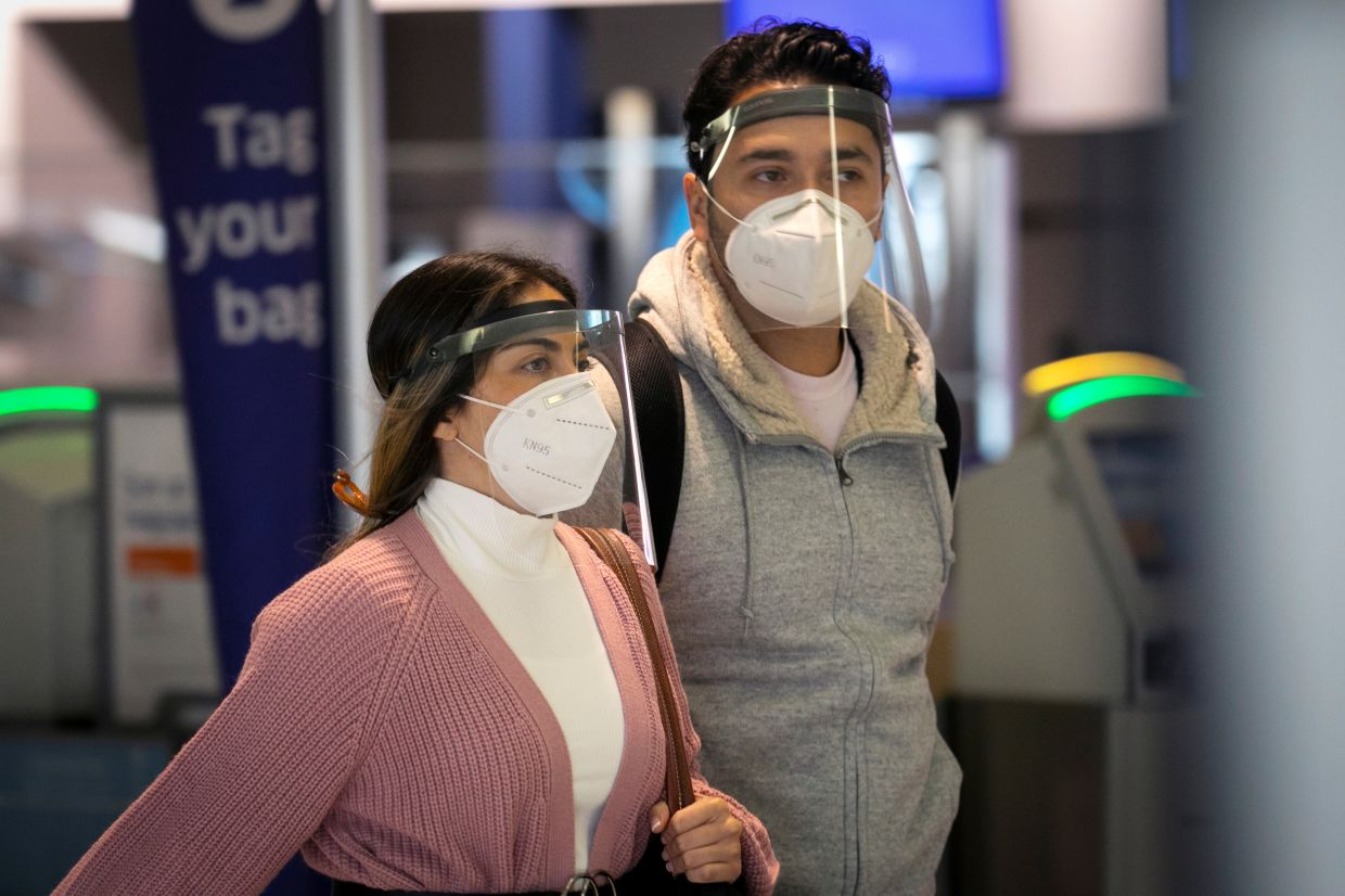 According to a recent report, medical ill-effects arising from Covid-19 were reduced when people wore face masks. — Reuters