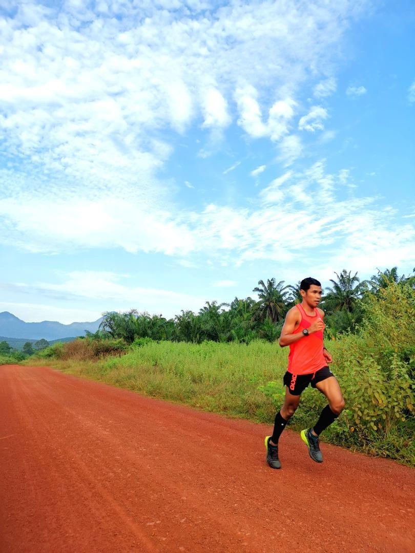 Muhaizar loves running in the palm oil plantations in Gurun, Kedah. Photo: MUHAIZAR MOHAMAD