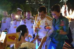 Thai king greets supporters amid protest rally at royal-linked bank