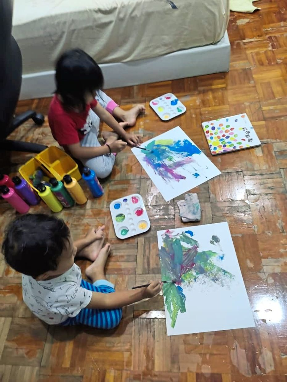 Among activities that Ong engages her children in include making arts and crafts and painting.
