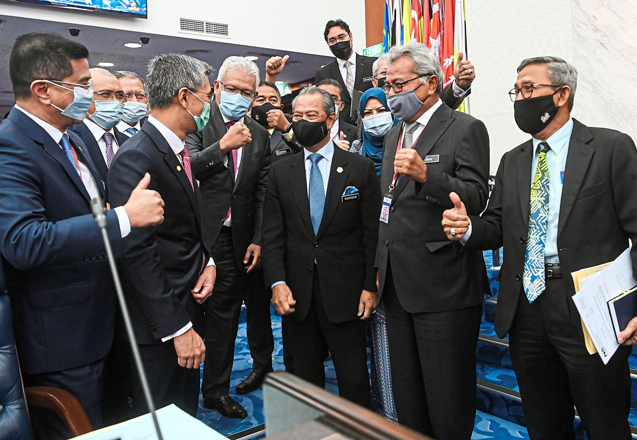 Thumbs up: Prime Minister Tan Sri Muhyiddin Yassin (third from right) sharing a light moment with Tengku Zafrul (second from left) as other Cabinet ministers look on. — Bernama