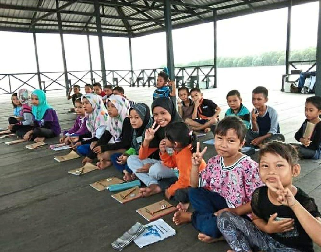 Pulau Mumiang's stateless kids are happy to learn while sitting on the jetty without comfortable chairs or a fan. Their classes are currently halted due to the conditional MCO.