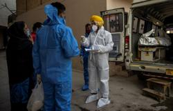 New Delhi ambulance group grapples with surging COVID-19 quarantine deaths