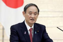 Japan's Suga vows stimulus package focusing on green, digital innovation
