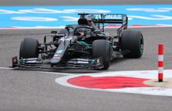 Hamilton sets early practice pace in Bahrain
