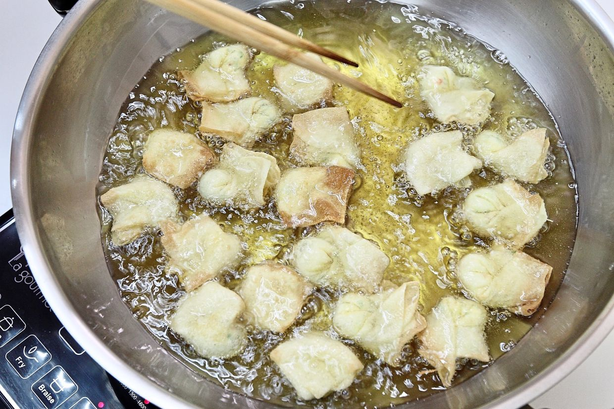 Fry the wonton in small batches until light golden then place on paper towels to remove oil.