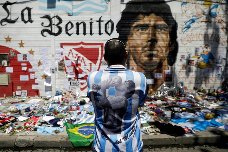A man mourns the death of soccer legend Diego Armando Maradona, outside the Diego Armando Maradona stadium in Buenos Aires, Argentina, Nov 27, 2020. - Reuters