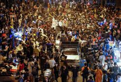 Thai protesters move to Bangkok suburbs; movements gathers more steam