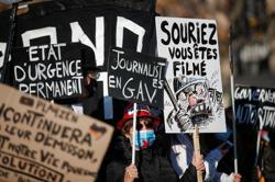 Protesters clash with police at Paris protest against police violence