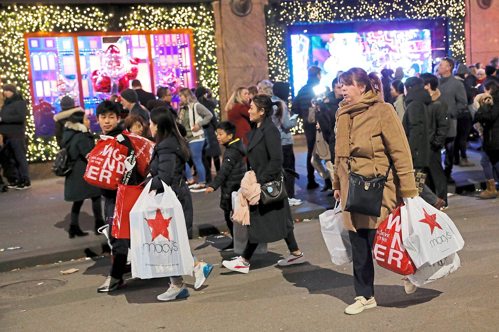 THING OF THE PAST: People carry shopping bags from Macy\'s Herald Square during early opening for the Black Friday sales in Manhattan, New York City, U.S., November 28, 2019. REUTERS/Andrew Kelly/File Photo