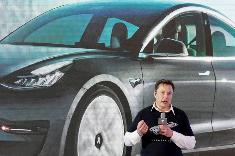 FILE PHOTO: Tesla Inc CEO Elon Musk speaks onstage during a delivery event for Tesla China-made Model 3 cars at its factory in Shanghai, China January 7, 2020. REUTERS/Aly Song/File Photo