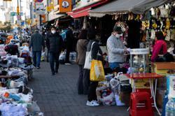 S. Korea to announce tighter virus curbs as cases rise