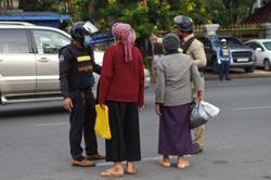 Asia Today: Cambodia tracks contacts after family infected; well-known mall closed