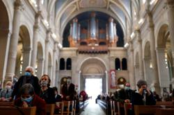 France must review COVID-19 crowd limits on church attendance