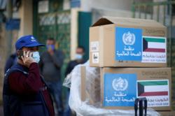 Gaza gets vital medical aid as hospitals struggle with rising infections