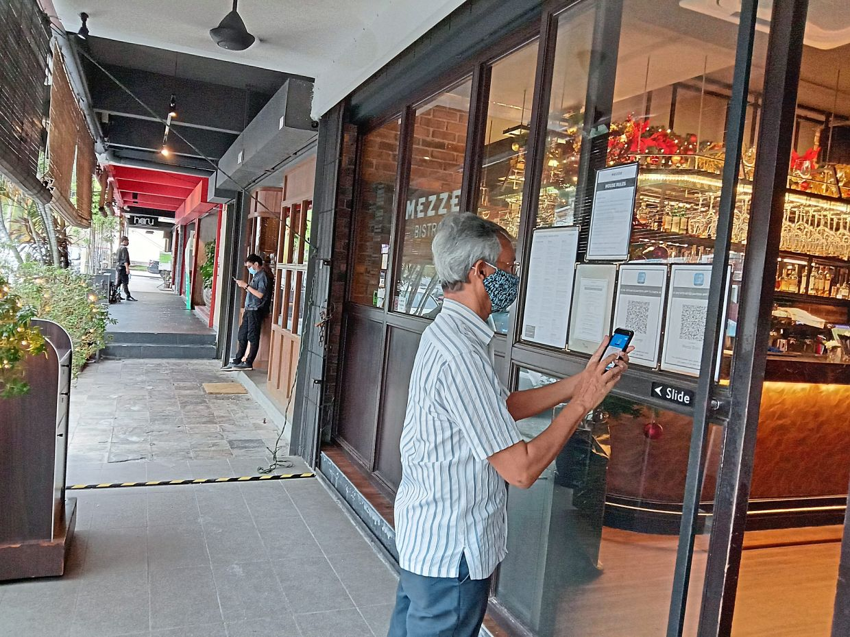 Nearby residents are happy that businesses along Jalan Kasah are gradually reopening. — Photo: GRACE CHEN/The Star