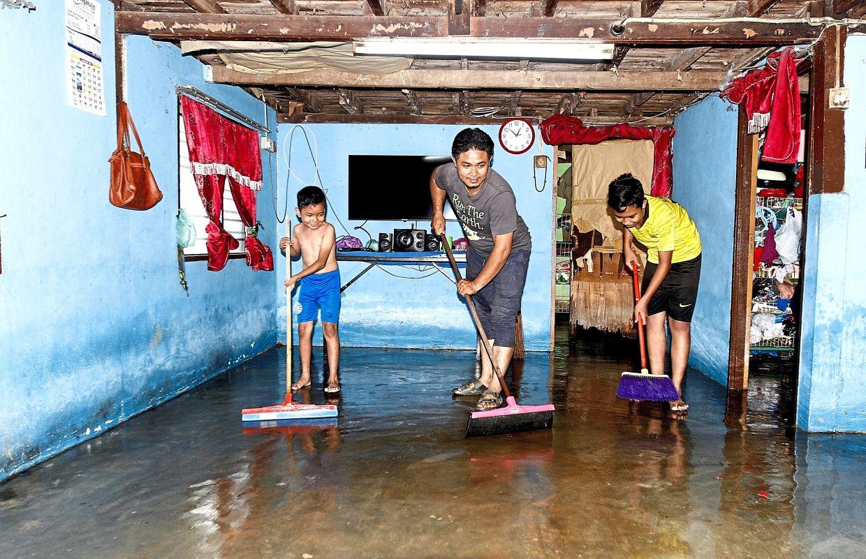 Shaharudin and his nephews cleaning up his grandmother's house in Kampung Permatang Rawa Tengah, Bukit Mertajam.