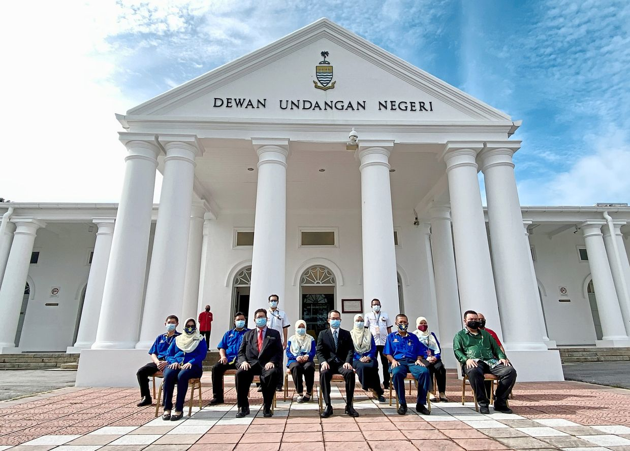 (Front row, from second left) Ahmad Rizal, Law and Roslan along with State Works Department and State Secretariat staff members in a group photo outside the newly renovated State Assembly building in Light Street, Penang. — Photos courtesy of Penang State Legislative Assembly office