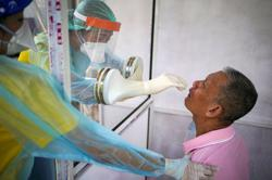 Thailand tracking 200 people as infected returnees skip COVID-19 quarantine