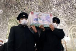 Iran begins burial of slain prominent nuclear scientist - TV