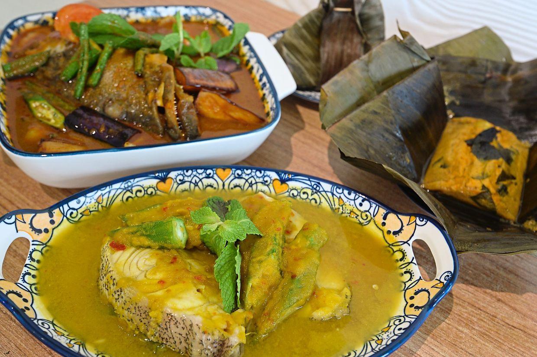 Popular main dishes at Restaurant Ai Jiak are (clockwise from left) fish head curry, otak-otak and Nyonya fish.
