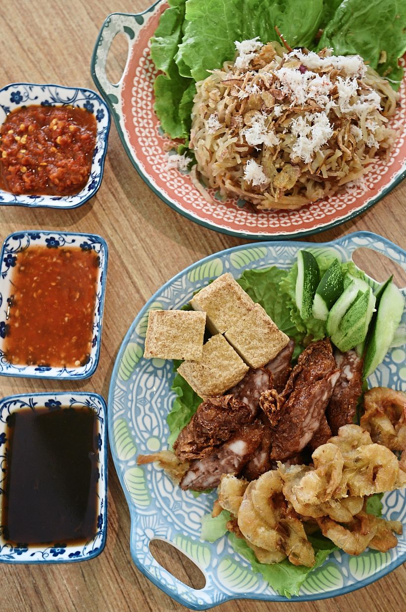 Some of the signature dishes are stir-fried turnip with cuttlefish (top) and the lobak set which comes with prawn fritters.