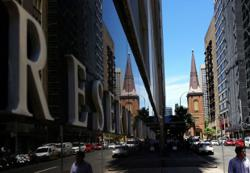 Australia central bank holds rates as housing market booms