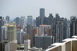 Singapore central bank urges prudence in property purchases as pandemic hits jobs