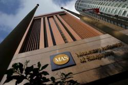 Singapore central bank urges prudence in property purchases