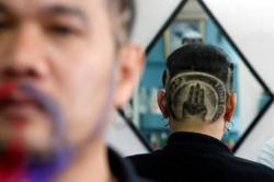 Change is in the hair: Thai royalist turns rebel