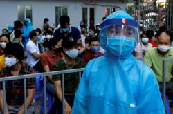 Vietnam reports 2 new COVID-19 cases linked to rare local infection