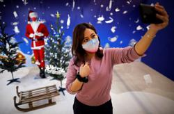 Tokyo pop-up mask store lures shoppers with festive face coverings