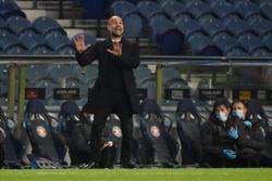 City's Guardiola turns focus to Premier League after European qualification