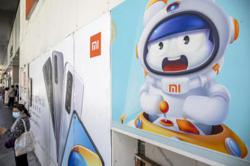 Xiaomi trade halted in Hong Kong by disclosure delay