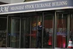 China shares end flat as healthcare losses offset gains in property stocks
