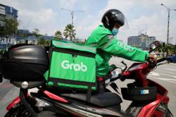 Grab, Gojek close in on terms for merger
