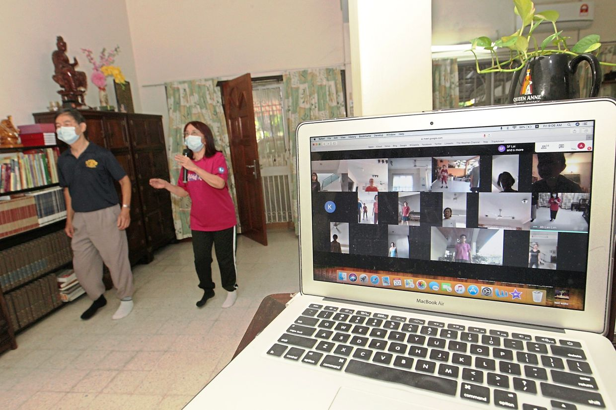 Koh (left) and Lim conducting a free online dance lesson for residents.