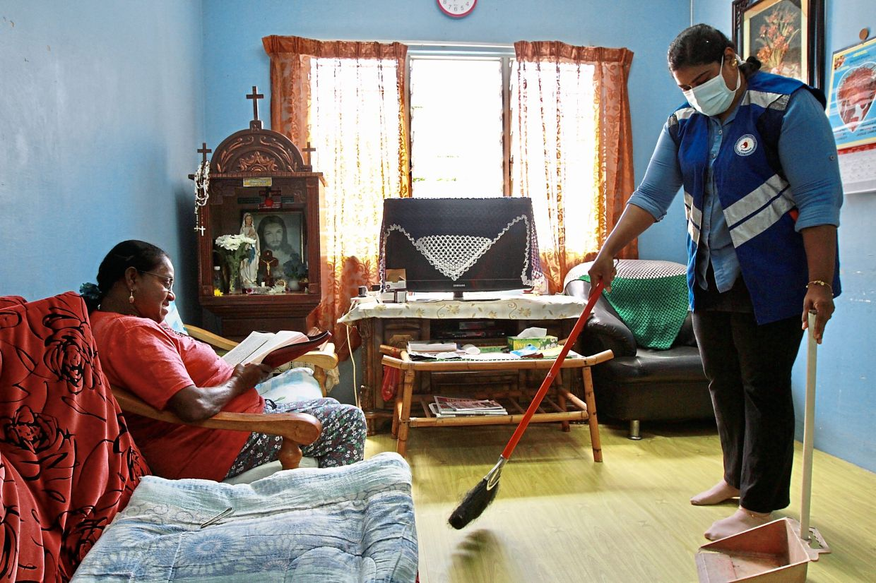 Dewathe helping to clean Anthony's house during one of her visits to PPR Seri Semarak.